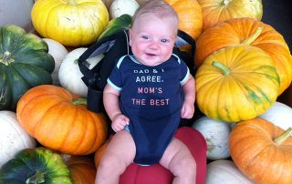 baby on gourds